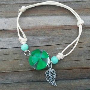 Four leaf clover lucky globe bracelet